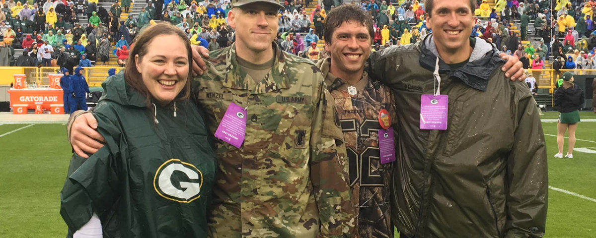 Natalie and Dustin Wenzel Honored for Operation Fan Mail at Lambeau Field