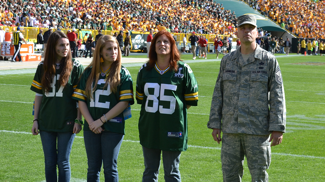 Accompanying Chief Master Sergeant Kevin Chronister to the game were his wife, Barb, and children, Samantha and Alyssa.