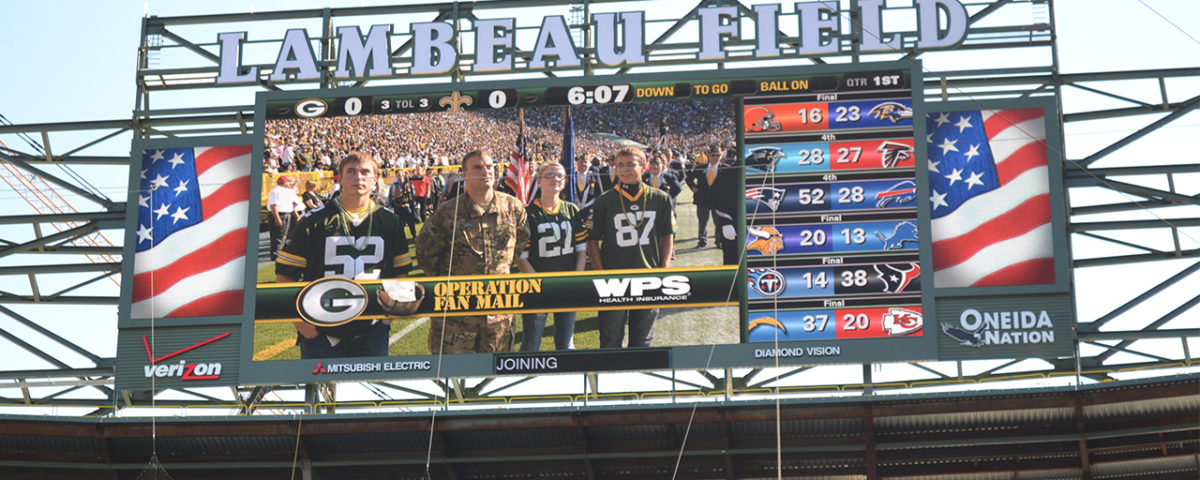 Accompanying U.S. Army Specialist Jason Jeffers to the game were his wife, Hannah, who lives in Appleton, Wis., while he is deployed, and his two brothers, Ben and Sam.
