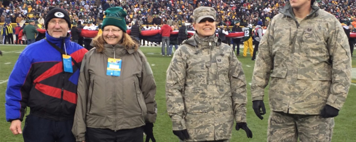 Technical Sgt. Danielle McDowell and her husband, Technical Sgt. Shane McDowell, are joined at Lambeau Field by her parents, Mark and Joan Carlson.