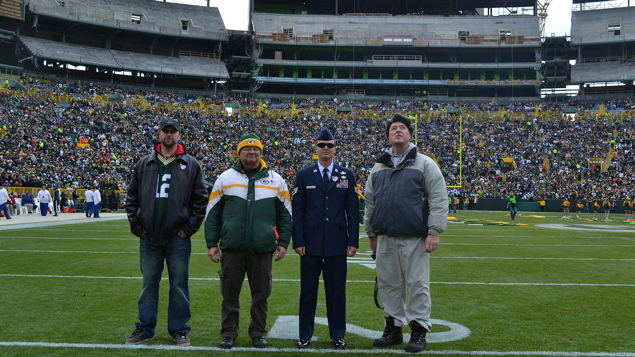 Accompanying U.S. Air Force Staff Sergeant Kevin Parke to the game were his father, Kent, his uncle, Lloyd Thorsbakken, and his friend, Cole Traynor.