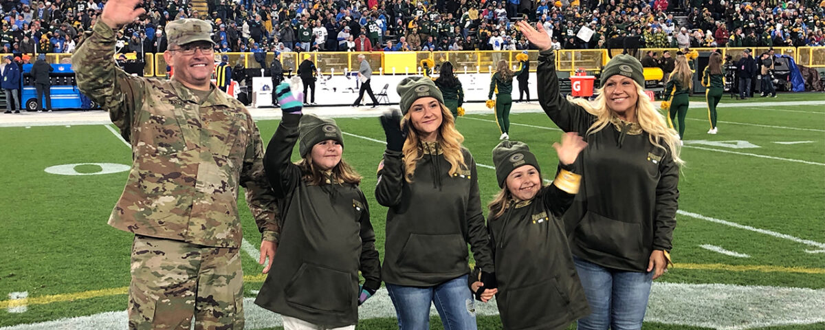 Army Major Terry Mercier is shown on the field with his wife, Nycole, and their daughters, Aryanna, Alyssa, and Gianna. (Photo by Jon Murphy/Green Bay Packers)