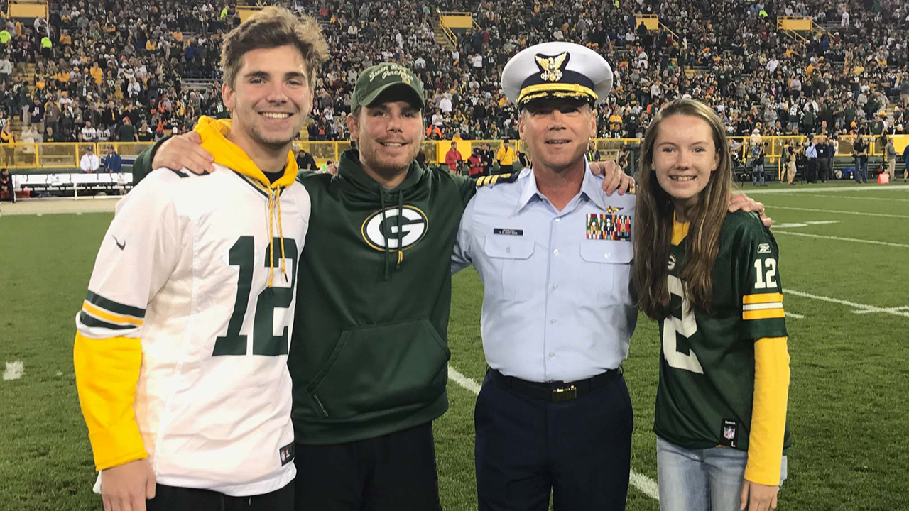 Commander Mark Graboski is shown on the field with his sons, Sean and Cameron, and daughter, Audrey.