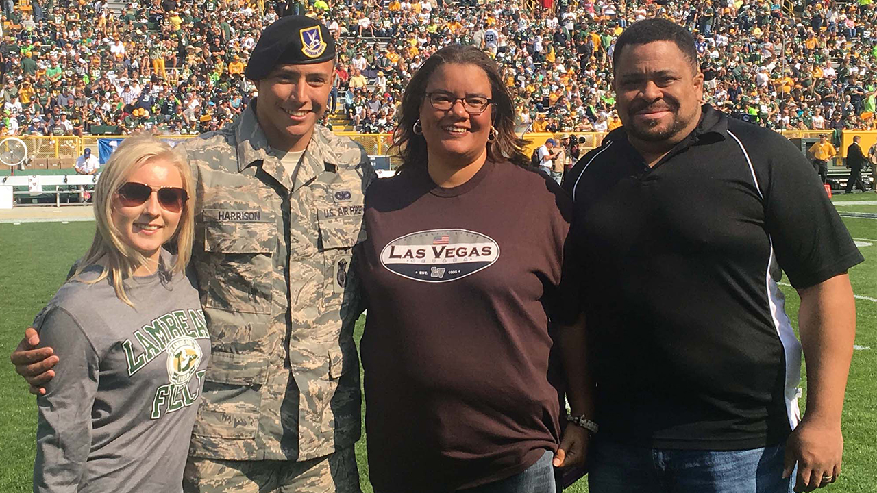 Senior Airman Zach Harrison is shown with his wife, Mikayla, and his aunt and uncle, Lorraine and John Gibson.