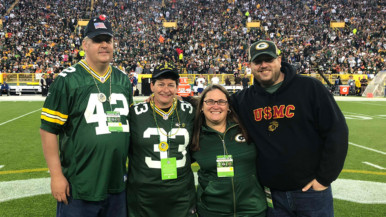 Terry and Jolene Switzer (left) are shown on the field with their friends, Jen Maksimchuk and Jesse Banda.