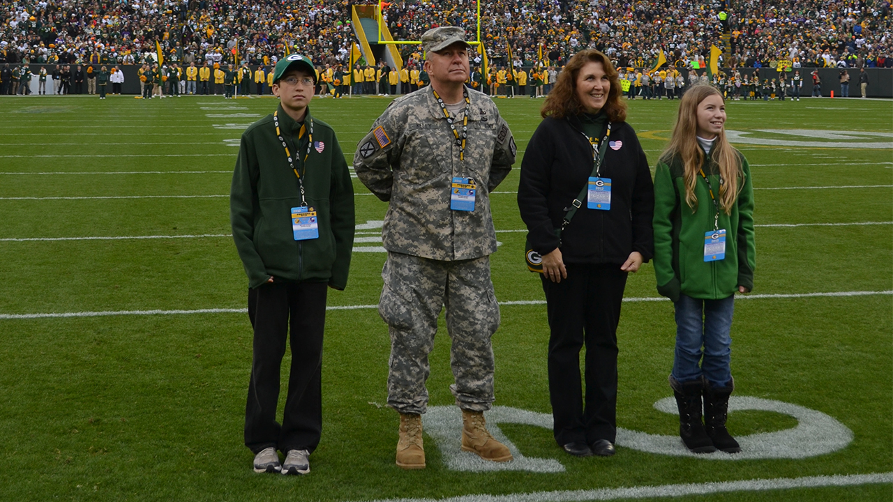 Accompanying U.S. Army Ordinance Corps Colonel to the game were his wife and two children.