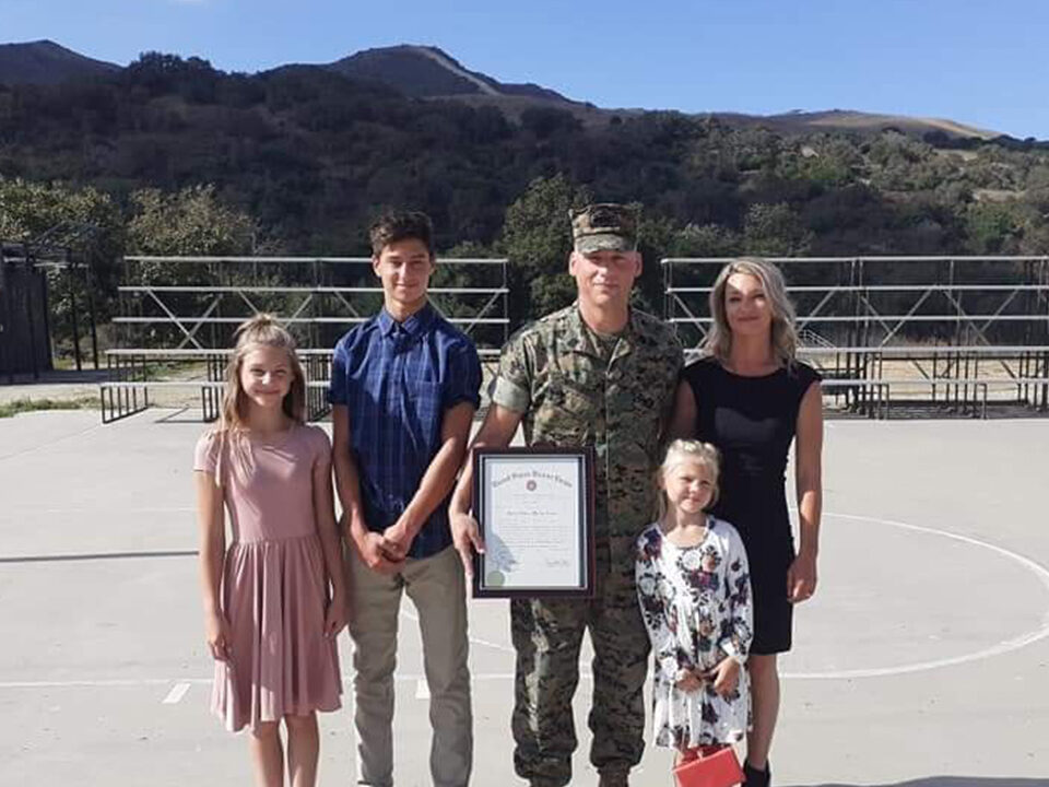 Marine Corps Gunnery Sgt. Thomas Wright is shown with his family.