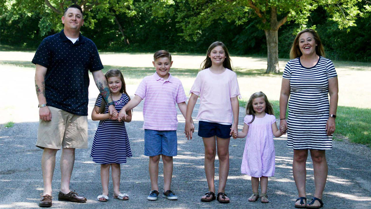 Army Sergeant First Class Joshua Friday with his family.